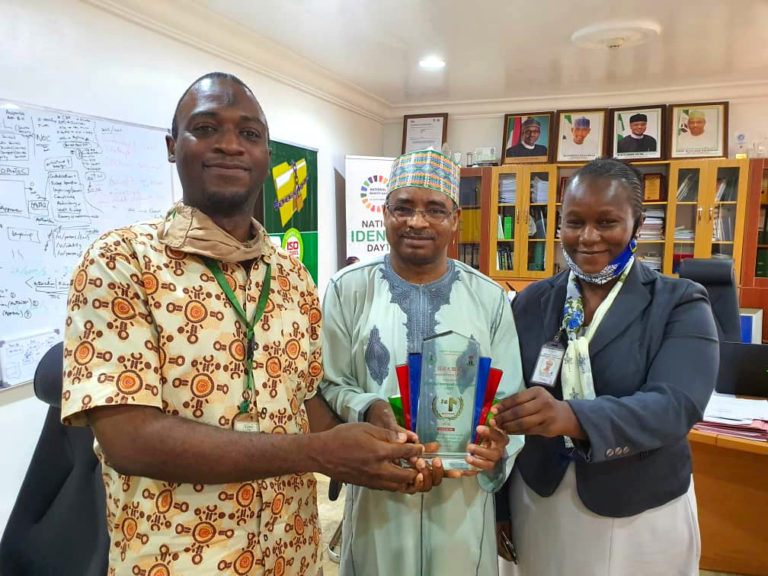 NIMC DG/CEO with the Corporate Web Management team holding the First Position award from BPSR